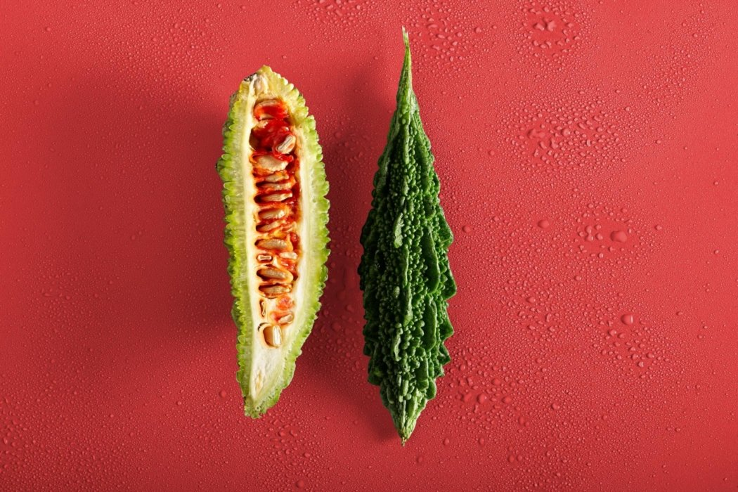 Raw cut in half fruit on a red background