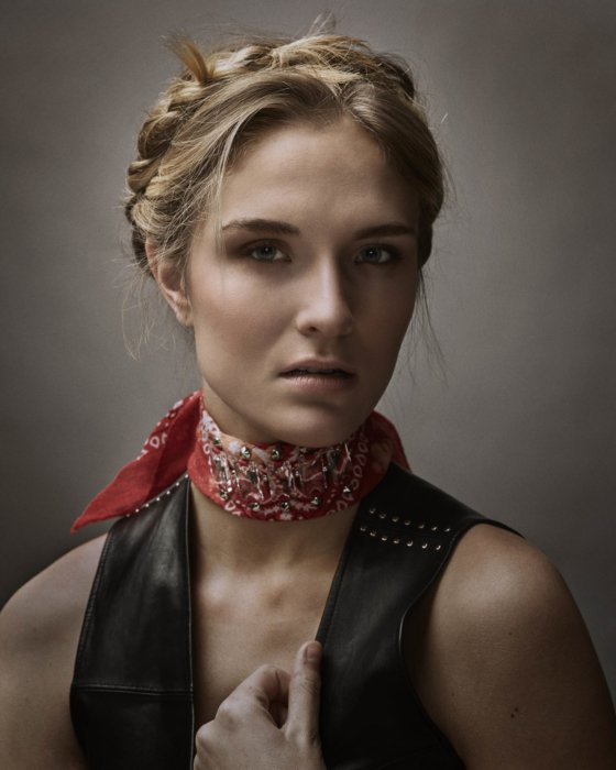 Fashion shoot of a blonde woman with a red bandana and leather vest