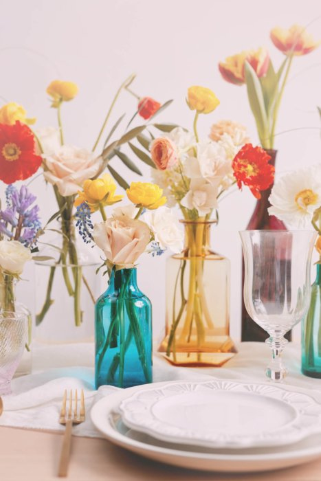 Close up of vases and flowers and plates