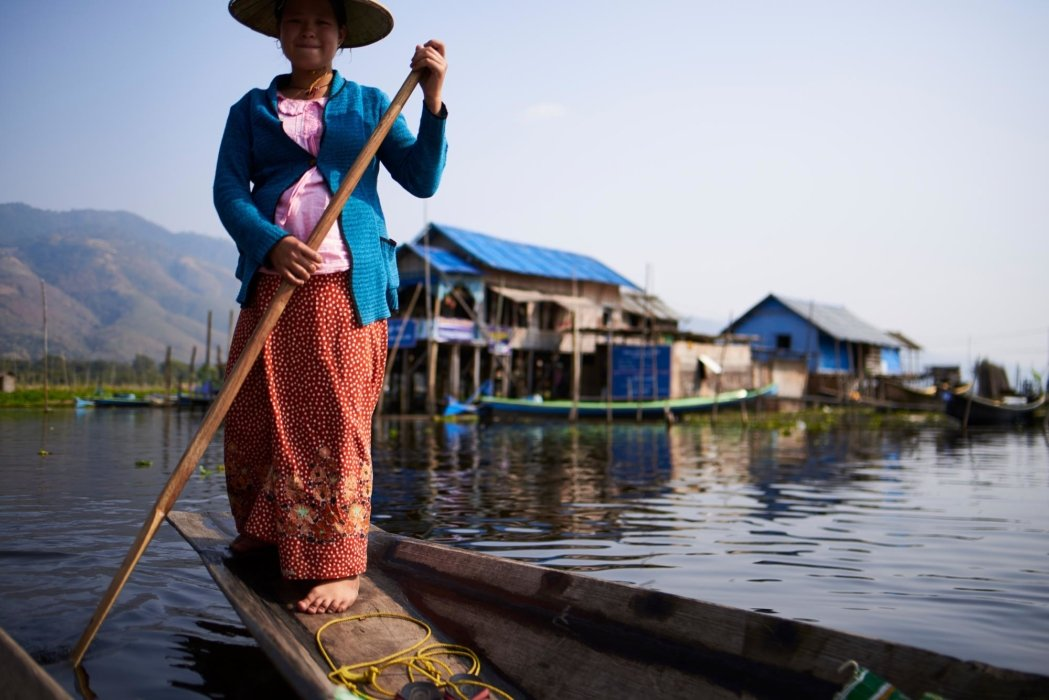 Travel photo of woman rowing a boat