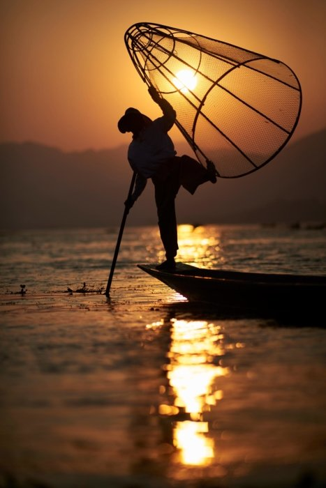Travel photo a fisherman at sunset
