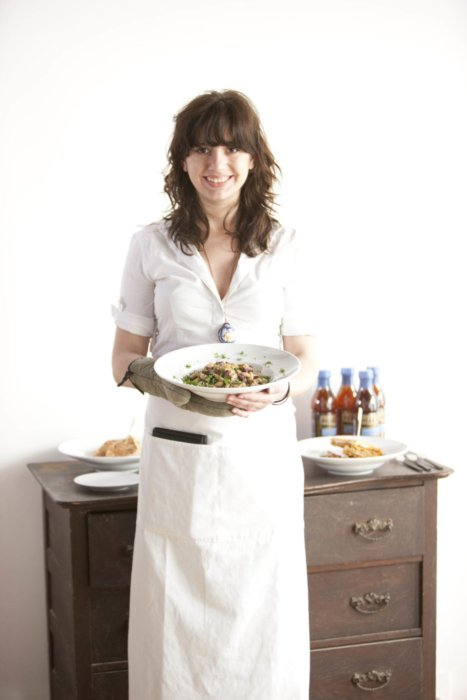 Lifestyle shot of a woman holding a dinner plate