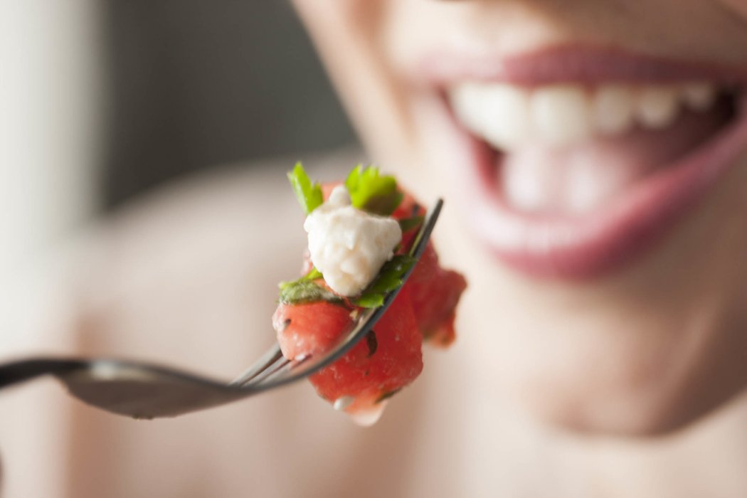 Lifestyle shot of a woman eating food