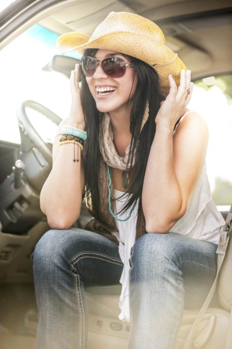 Lifestyle shot of a woman in car - lifestyle photography