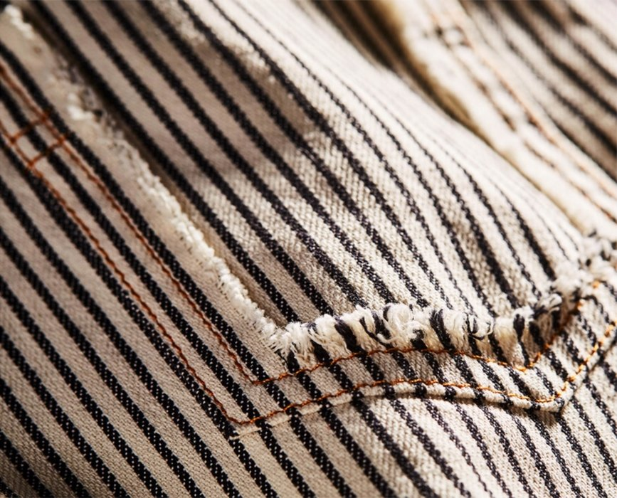 Tattered stripped vest close up