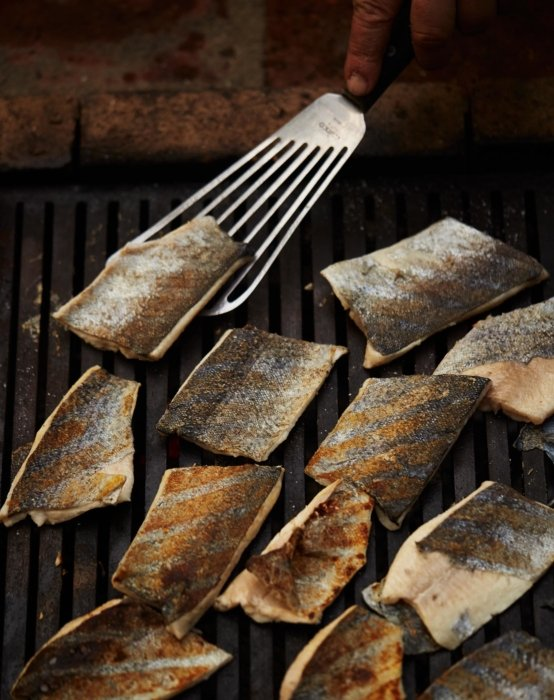 Grilled fish with spatula