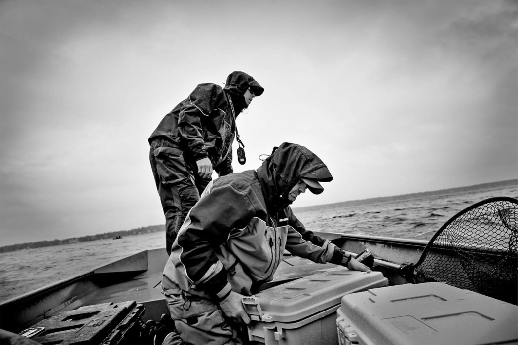 Two firsherman on a boat in stormy weather - black and white - outdoor photography