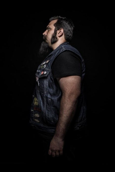 Portrait of a man with beard - dark background