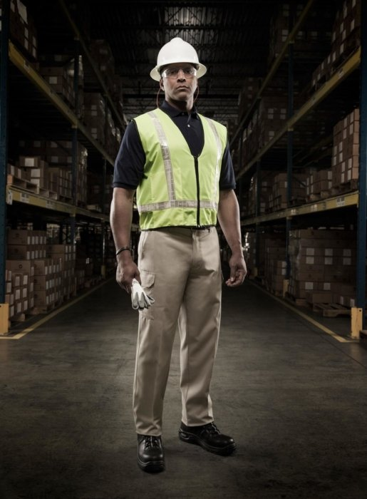 A worker in a hard hat in a warehouse