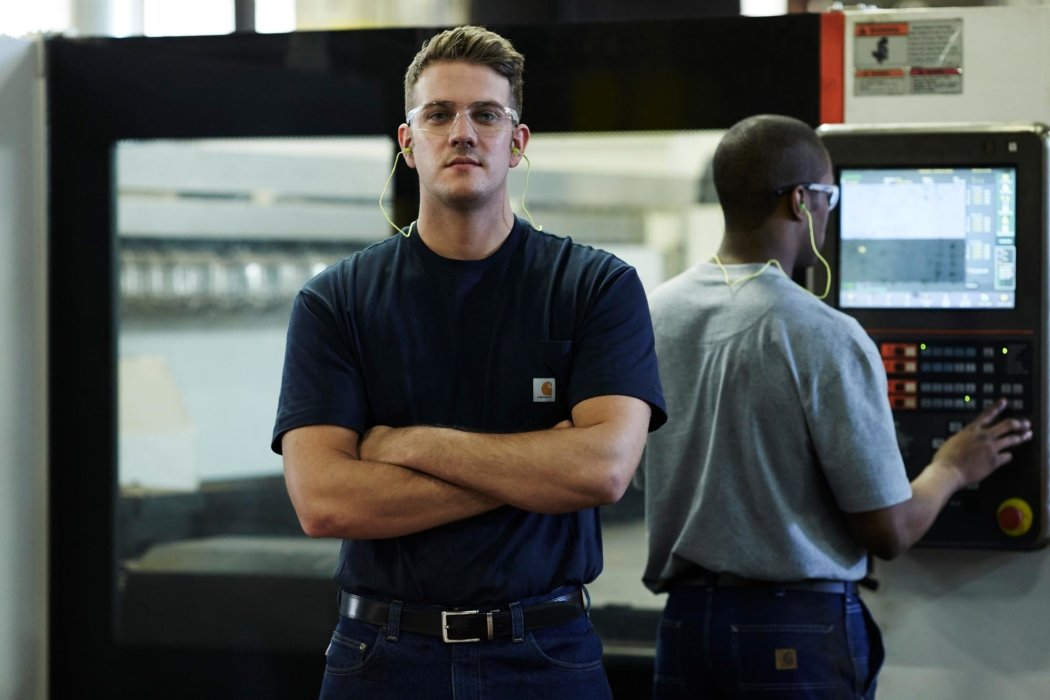A hero portrait of a worker in a facility