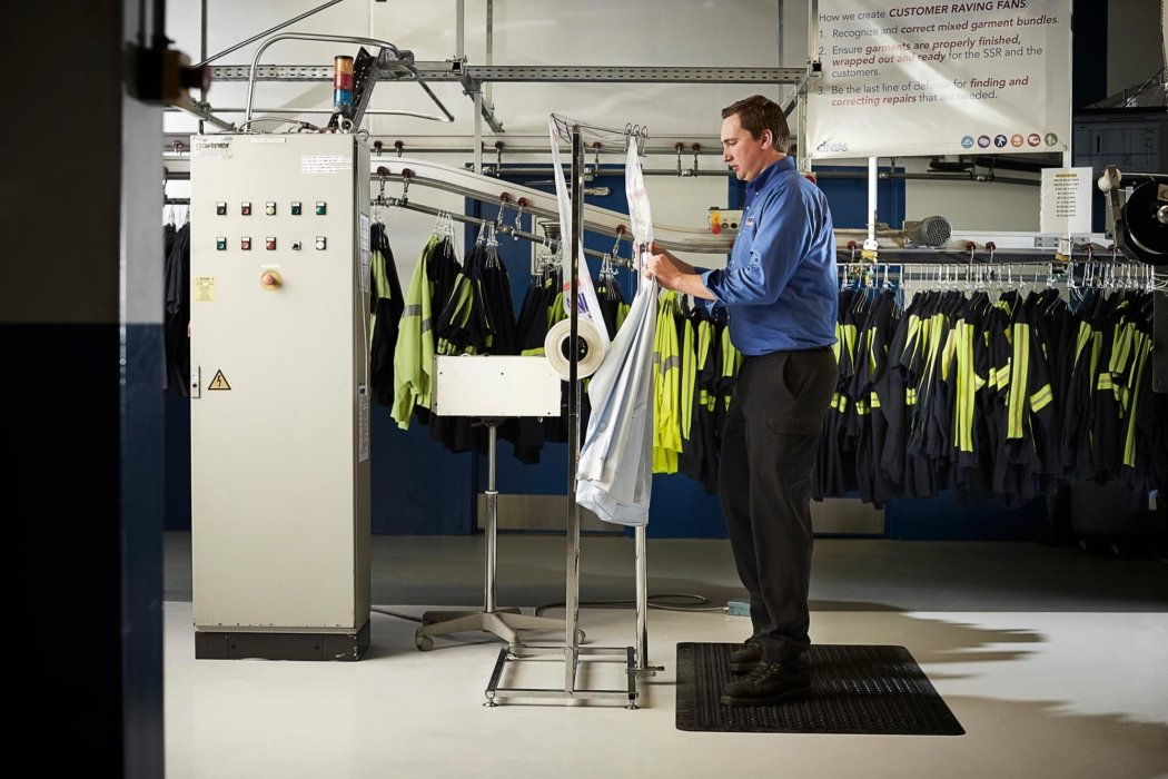 A working working with clothing automation