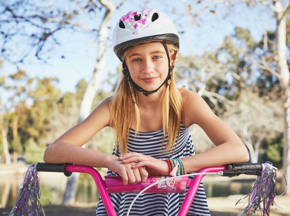 Young girl with pink bike and helmet - lifestyle photography