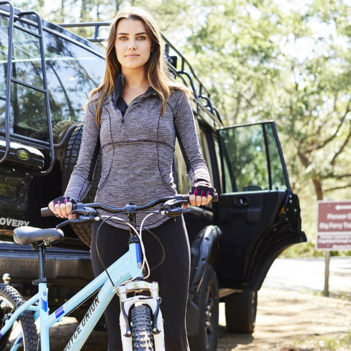 Athletic woman getting ready to ride a bike - lifestyle photography