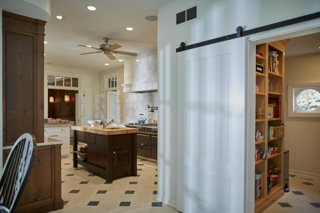 Interior architecture inside classic home kitchen with farm doors