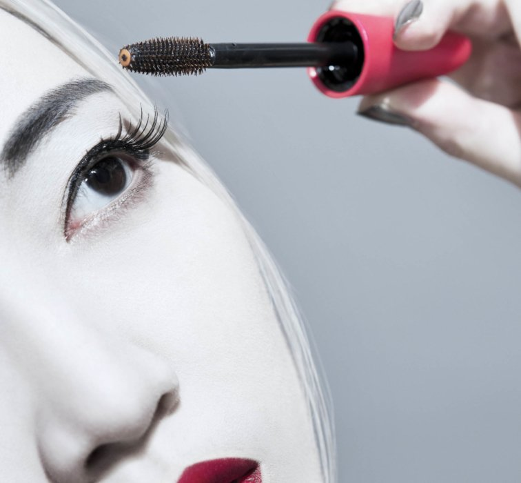 Beauty shot of a woman applying eyelash volumizer - - Cosmetics photography
