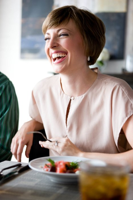 Woman laughing at a dinner party - - lifestyle photography