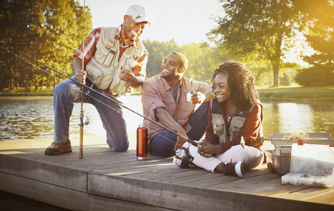 A family of three generations fishing - lifestyle photography