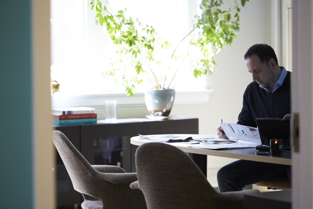 A business guy working in an office space. - lifestyle photography