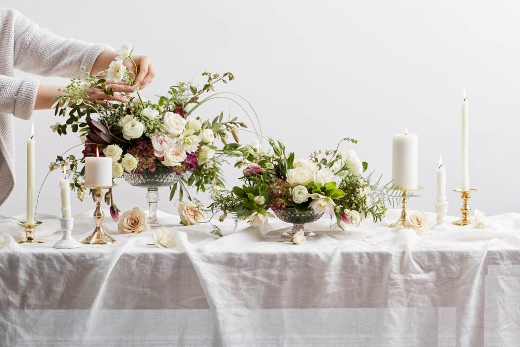 A table of flower bouquets and candles