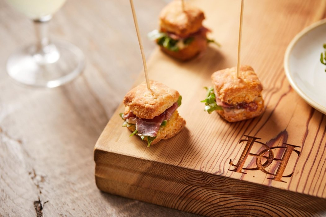 Appetizer bites on a wooden plate