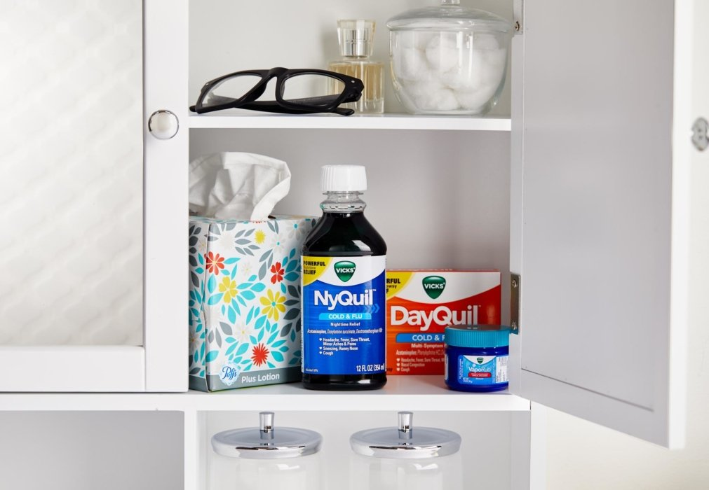 NyQuil and DayQuil in a cabinet