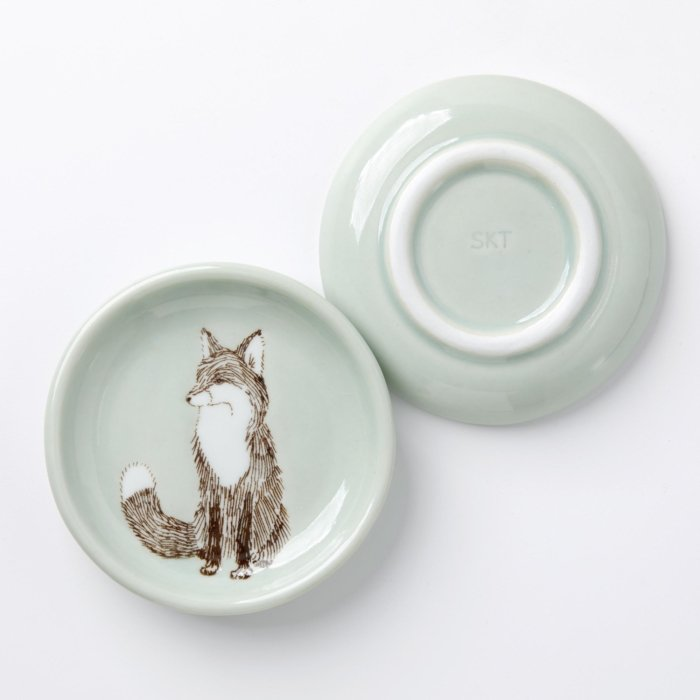 Artistic plates on a pale background