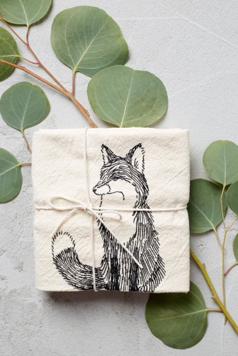 Line drawing of a fox on a cloth