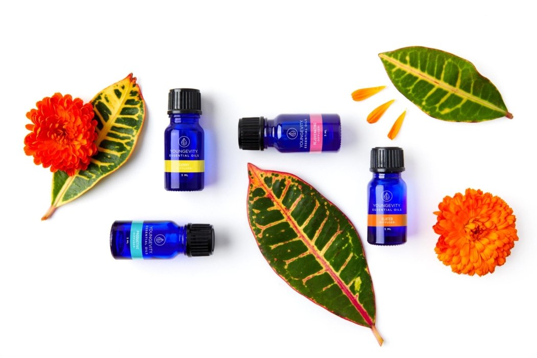 Youngevity oils with leaves and flowers