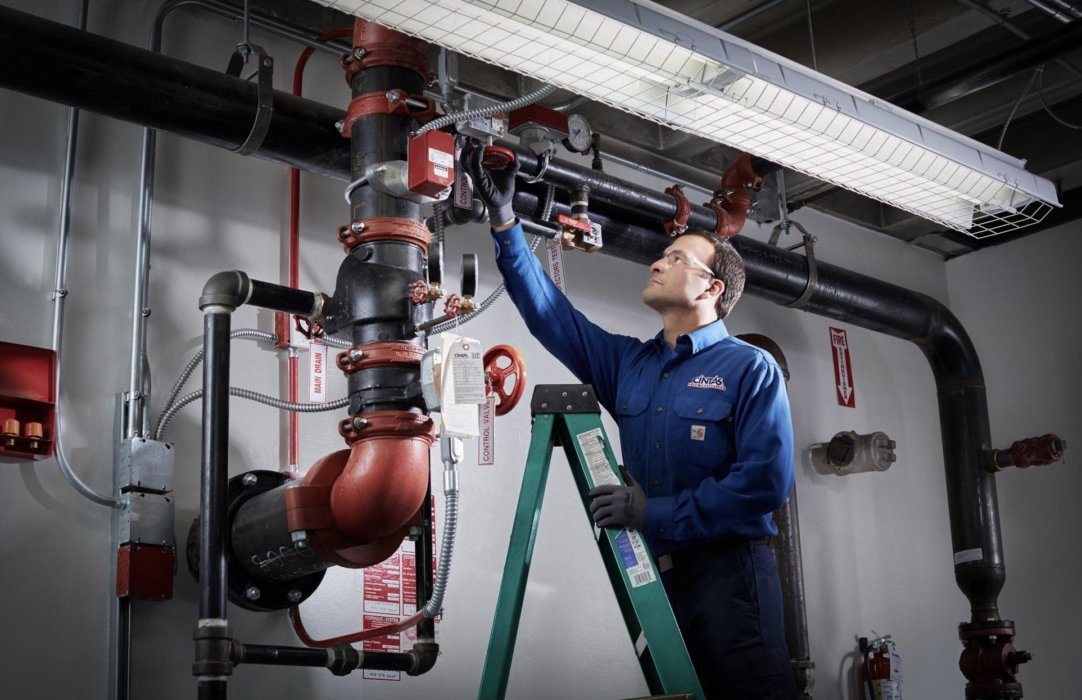 A man performing safety check on pipes in a facility - lifestyle photography
