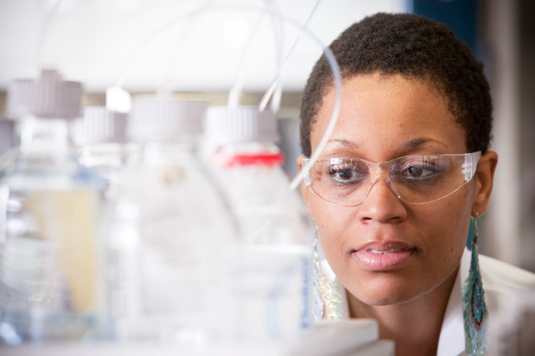 A woman looking at lab equipment