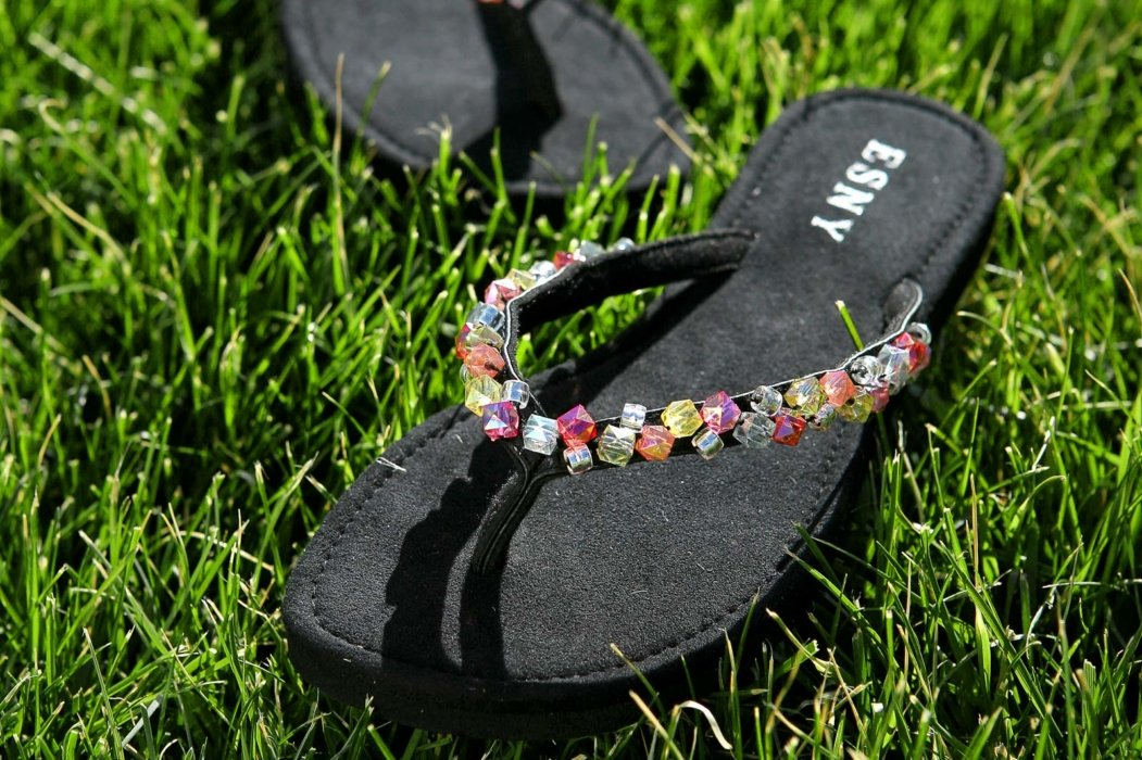 Totes Isotoner sandals on grass