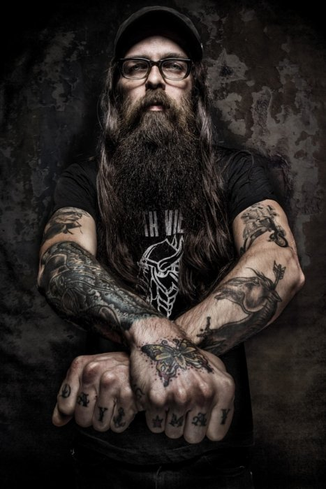 Portrait of a bearded man with tattoos