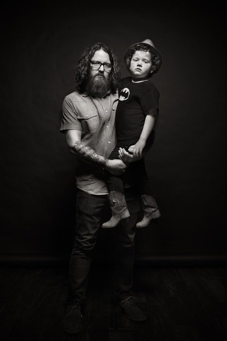 Portrait of a bearded man with child