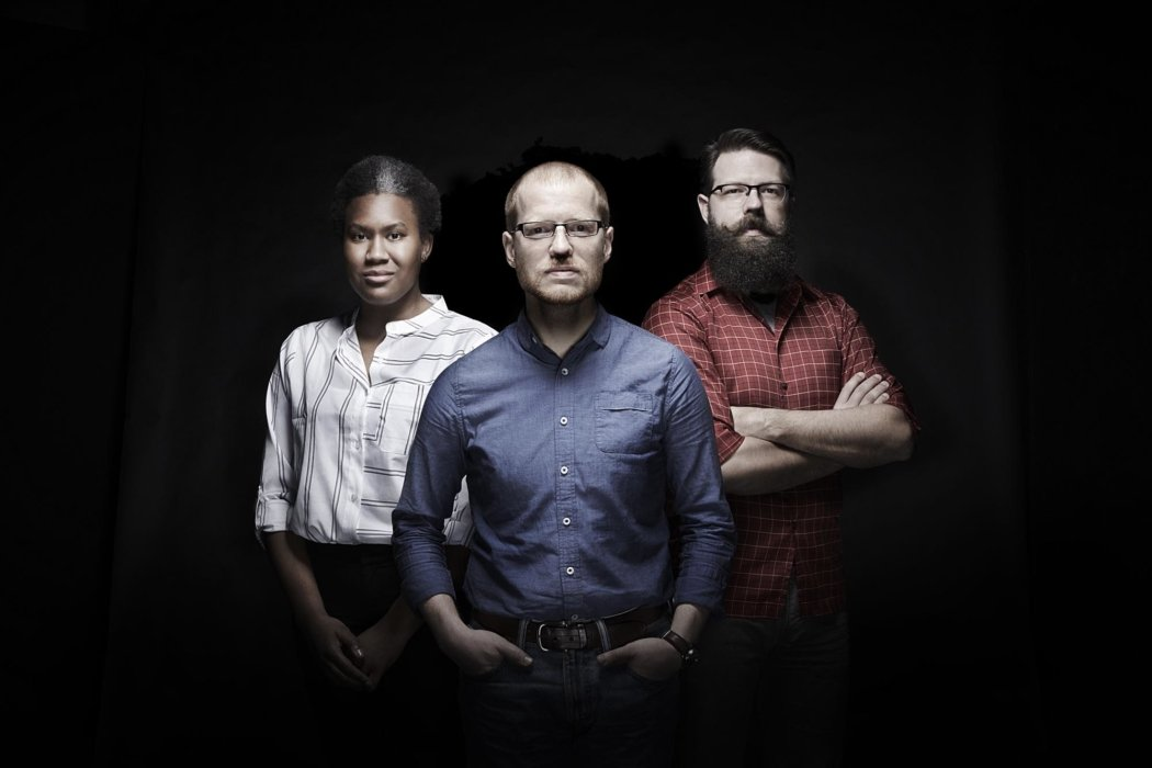 Portrait of three people on a black background