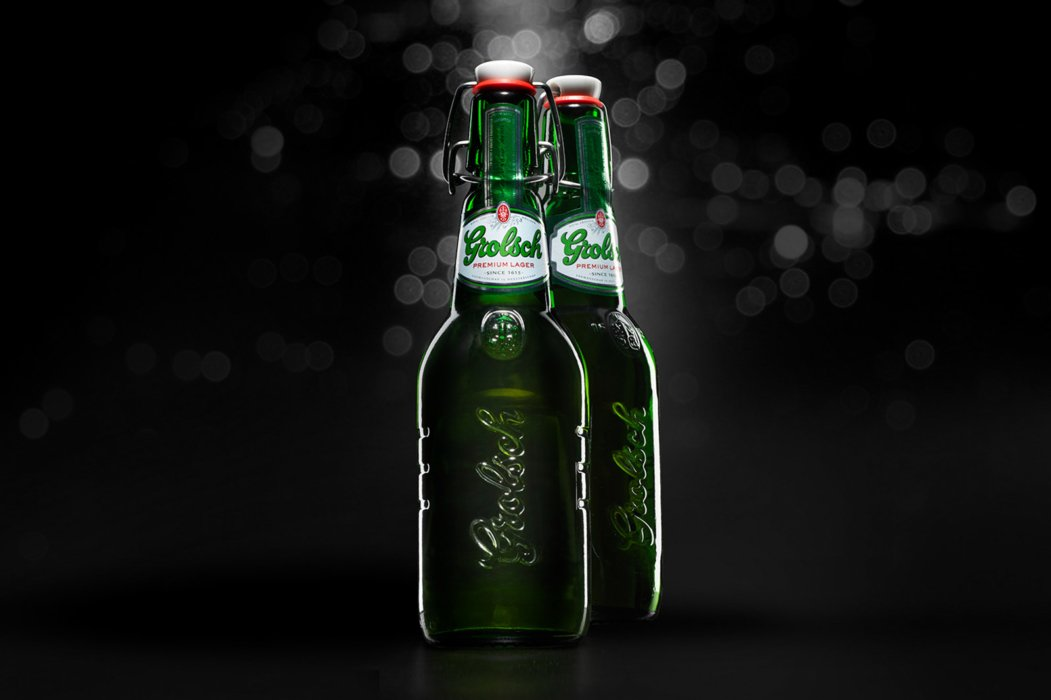 Grolsch green beer bottles on a black background