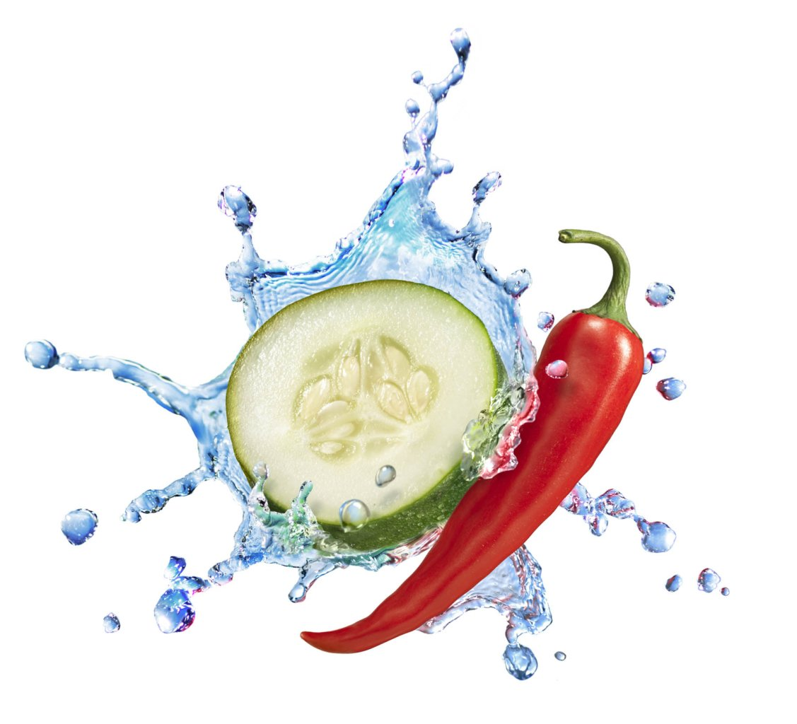 Water splashing with cucumbers and pepper