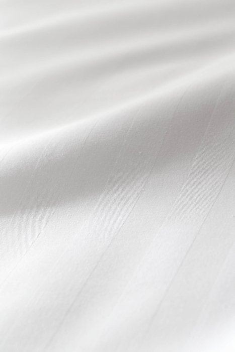 Close up of white textured textile fabric