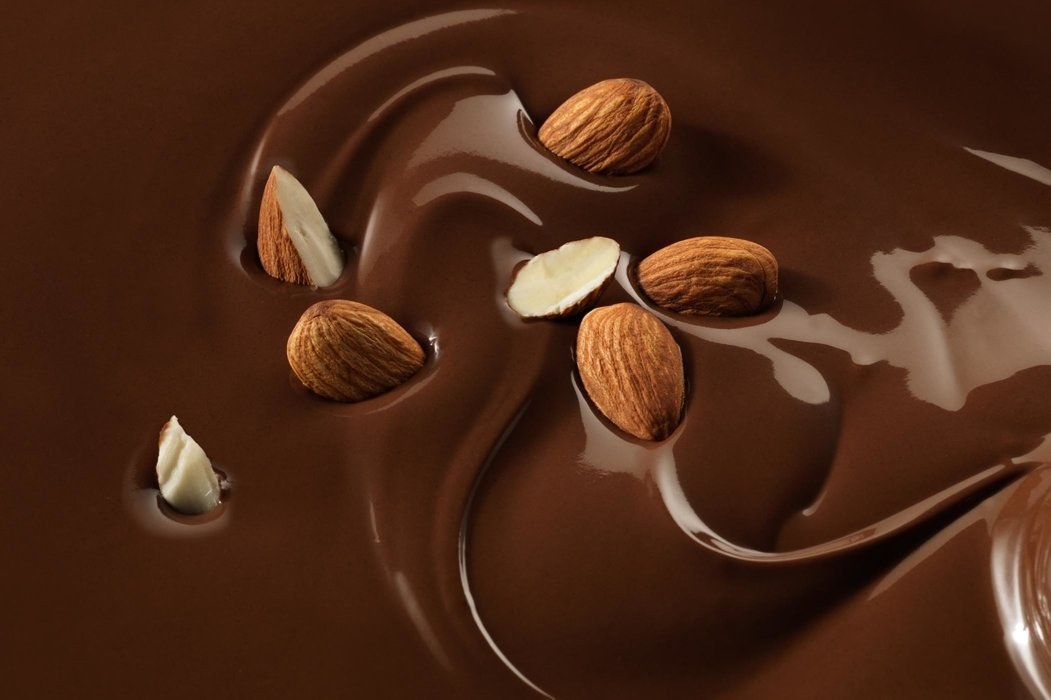 Splash and mix of almonds in chocolate