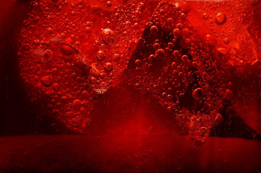 A bubbling splash of red liquid