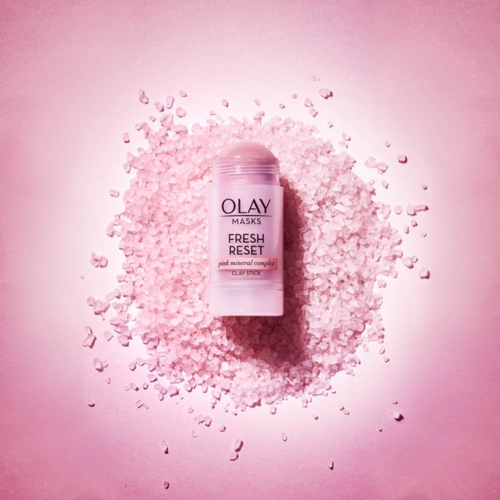 Pink olay product on a pink background - cosmetics photography