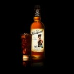 Blackheart Rum bottle and tall glass of cola and rum - Drink Photography