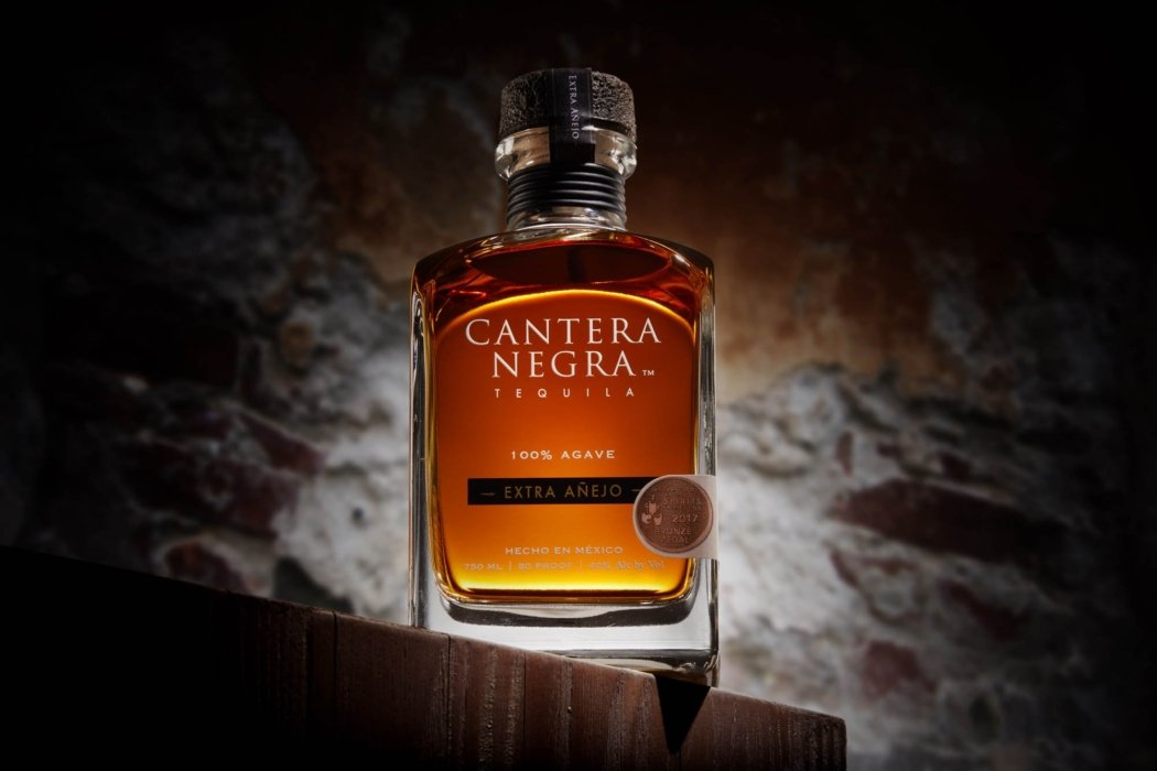 Cantera negra bottle with a rustic background - social media photography