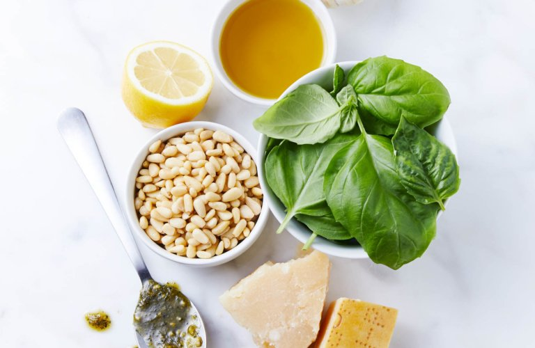 The ingredients to make pesto on marble - Raw Food Photography