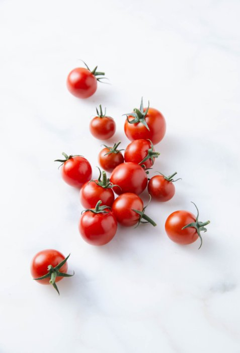 Small vine ripe tomatoes on marble - Raw Food Photography