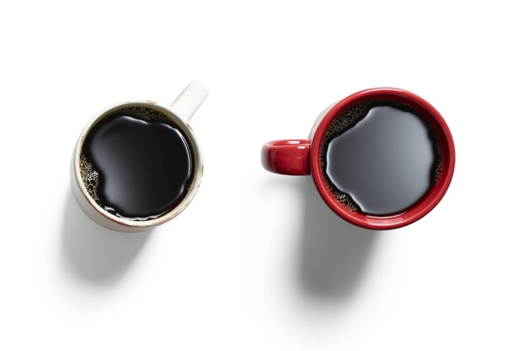 Drink photography - two coffee cups with black coffee on a white background
