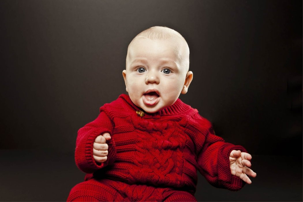 People photography - a portrait of a baby wearing a red sweater