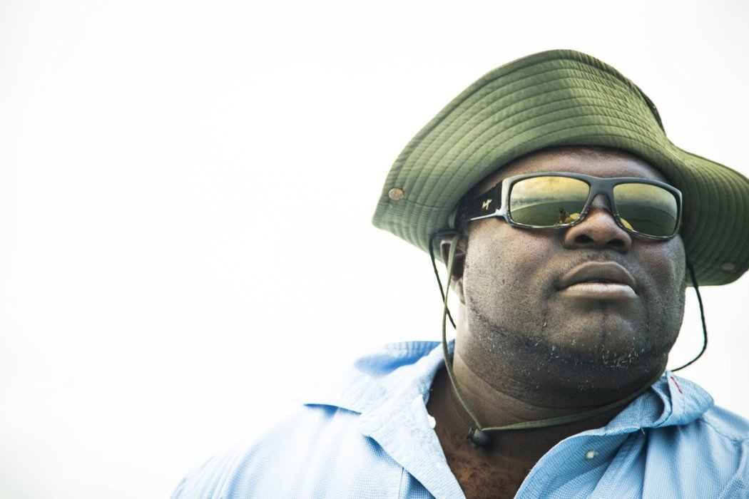 Portrait of a black fisherman with sunglasses