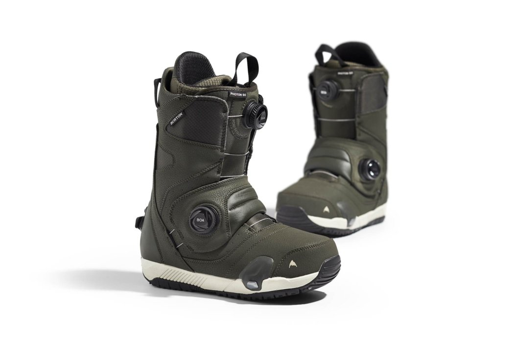 Product photography - two green ski boots with BOA fit system