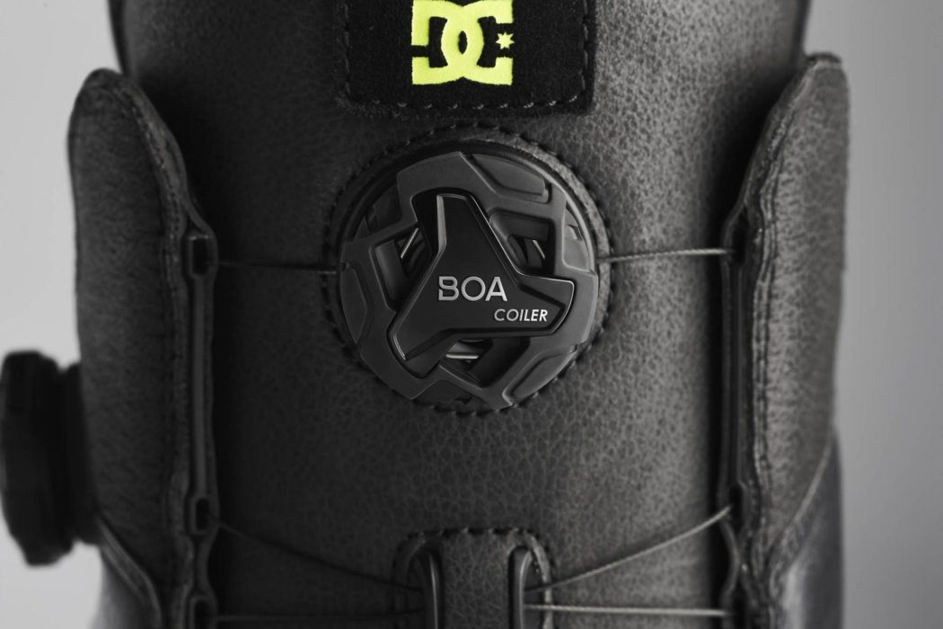 Product photography - Feature of green and black DC ski boots with BOA fit system