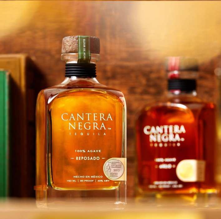 Reposado tequila in a copper library setting - canter negra - drink photography